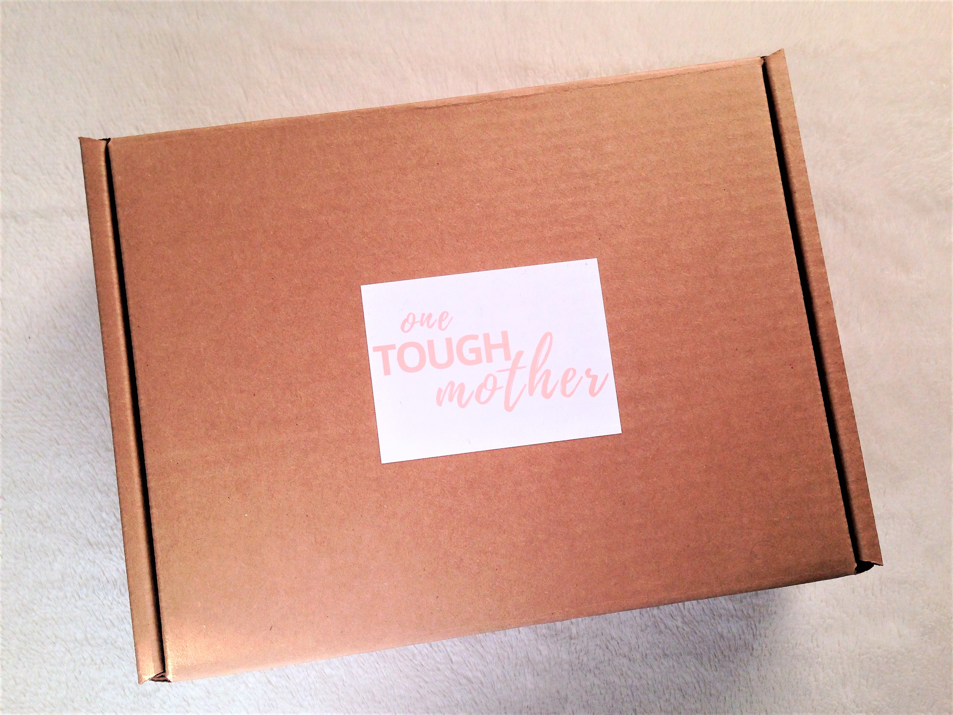 one tough mother postpartum care kit packaging